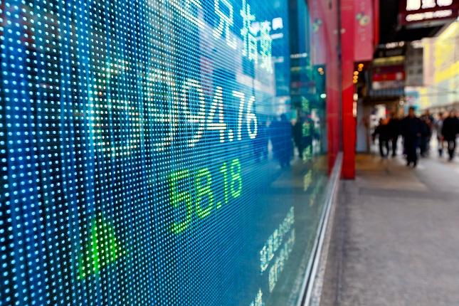 Global Stocks Steady as Merkel Holds onto Power in Germany
