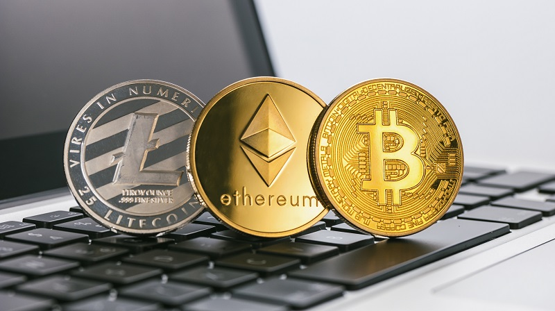 Bitcoin, Ethereum, Litecoin Digital cryptocurrencys on a notebook