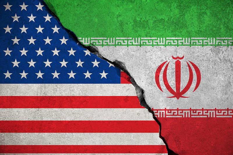 iranian flag on broken wall and half usa united states of america flag
