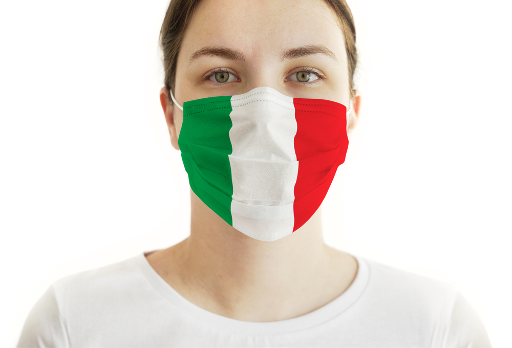 Coronavirus COVID-19. Young Woman With Face Mask