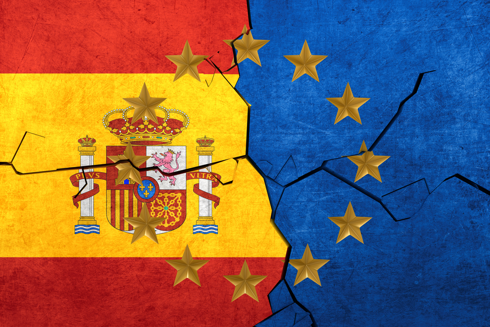European union and Spainish flags breaking apart