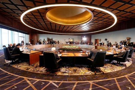 FILE PHOTO: Leaders attend the retreat session of the APEC Summit in Port Moresby, Papua New Guinea
