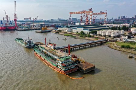 FILE PHOTO: Oil tankers are seen at a terminal of Sinopec Yaogang oil depot in Nantong