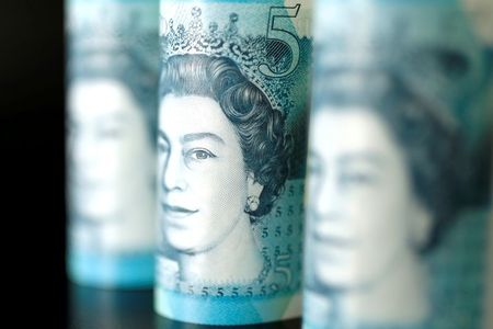 British five pound banknotes are seen in this