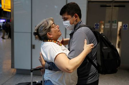 Karen Tyler embraces her son Jonathan who arrived from the