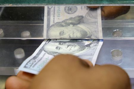 Dollar Slips After Last Week's Climb as Data Eases Tapering Fears