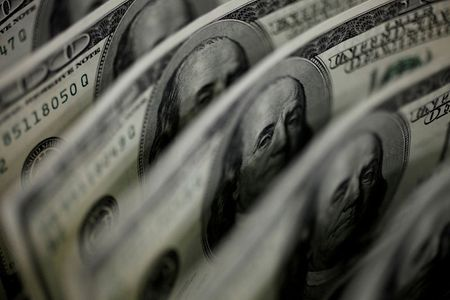 Dollar Jumps After Fed Official's Taper Talk Stirs Markets