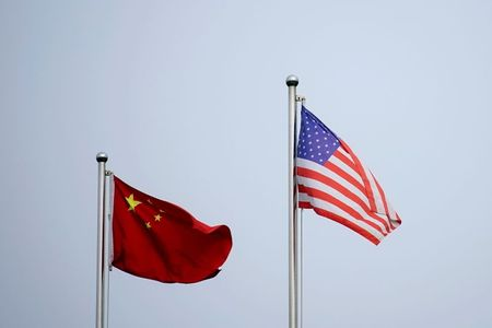 FILE PHOTO: Chinese and U.S. flags flutter outside a company