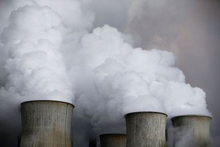 FILE PHOTO: Steam rises from the cooling towers of the coal power plant of RWE in Niederaussem