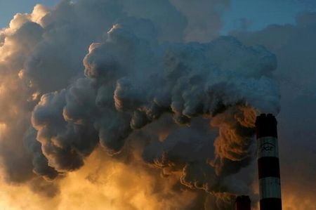 FILE PHOTO: Smoke and steam billow from Poland's Belchatow Power Station, Europe's largest coal-fired power plant
