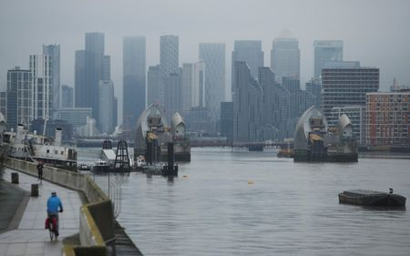 Buildings are seen in the Canary Wharf business district, amid