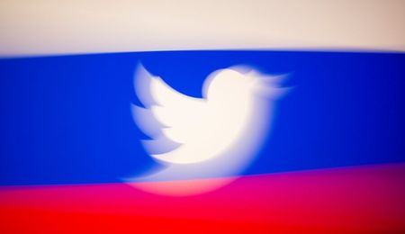 Twitter logo and a Russian flag are displayed in this