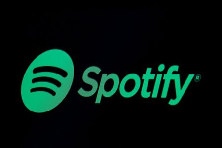 The Spotify logo is displayed on a screen