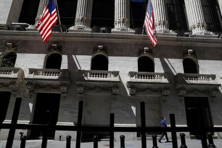 A trader walks outside the New York Stock Exchange in