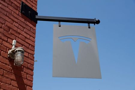 The TESLA logo is seen outside a dealership in the