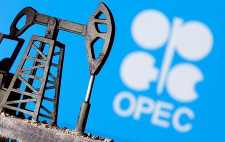 FILE PHOTO: A 3D printed oil pump jack in front of the OPEC logo in this illustration picture