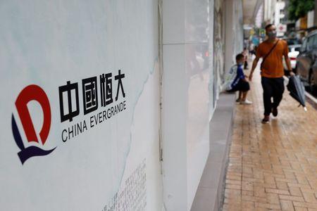 Stocks Slip, Yen Jumps as Evergrande Jitters Return
