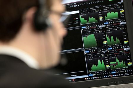 A broker looks at financial information on computer