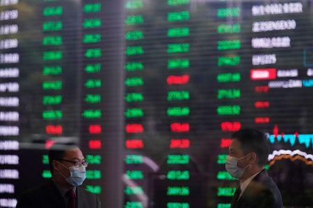 Men wearing face masks are seen inside the Shanghai Stock