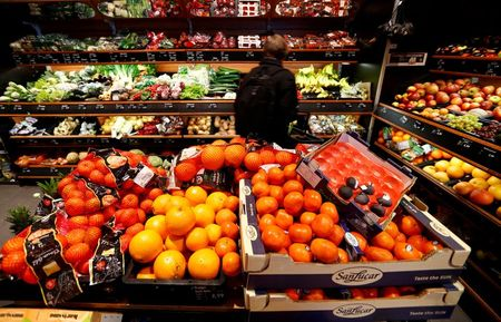 Full shelves with fruits are pictured in a