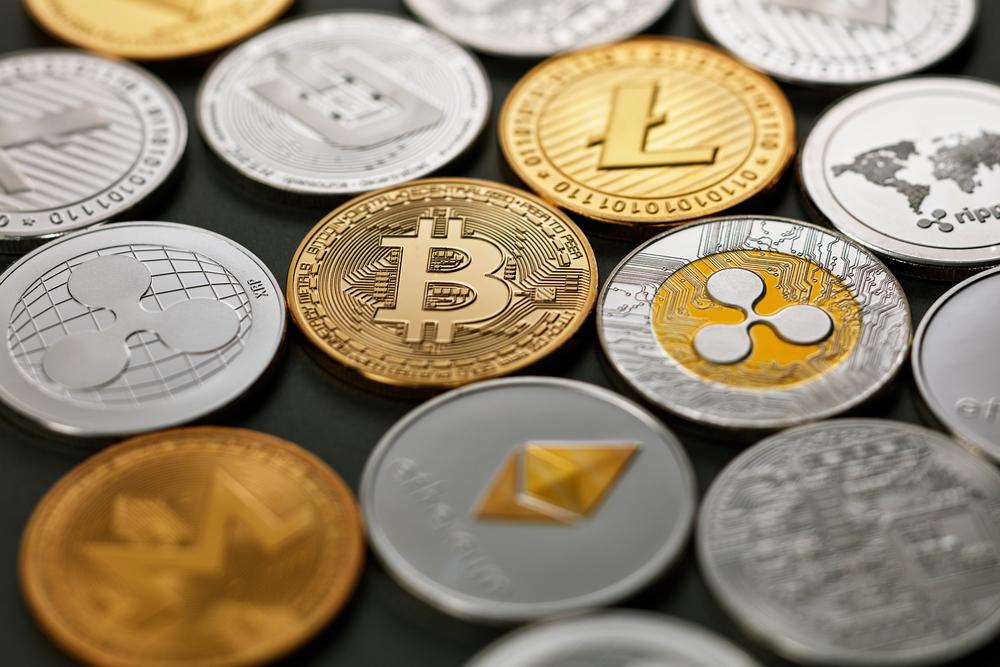 Pattern of coins LTC, ETH, BTC, XMR, XRP on a dark background. Business concept.